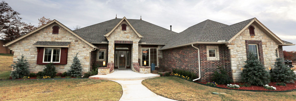 Left: This model home is at 13736 SE 95 in the Foxmor Estates neighborhood in southeast Oklahoma City.  Photos by Nate Billings, The Oklahoman
