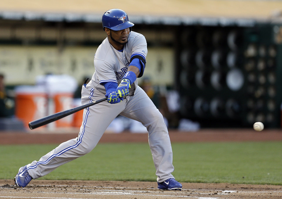 Photo - Toronto Blue Jays' Edwin Encarnacion grounds into a fielder's choice in the first inning of a baseball game against the Oakland Athletics on Saturday, July 5, 2014, in Oakland, Calif. Encarnacion left the game with an injury after tripping while running to first base. (AP Photo/Ben Margot)