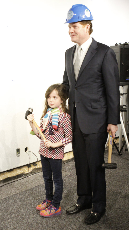 Photo - Bob Ross, president and CEO of the Inasmuch Foundation and his daughter Lilly, 7,  hold a hammers during a wall breaking ceremony at the Oklahoma City National Memorial & Museum in Oklahoma City, Wednesday January 8, 2014. Photo By Steve Gooch, The Oklahoman