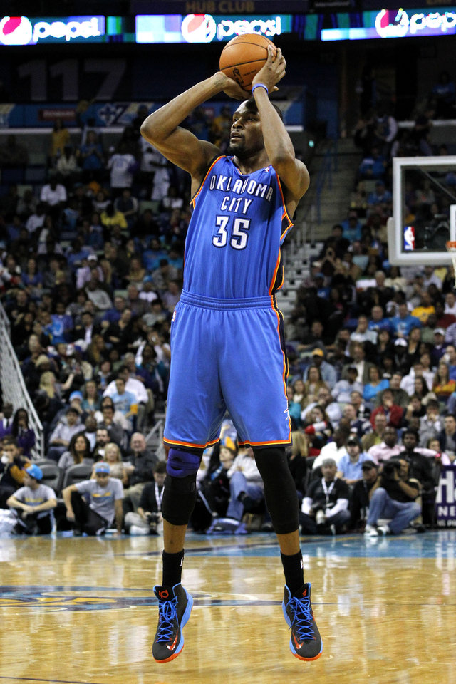 Photo - Oklahoma City's Kevin Durant (35) shoots the ball during the second half of an NBA basketball game against the New Orleans Hornets in New Orleans, Friday, Nov. 16, 2012. The Thunder won 110-95. (AP Photo/Jonathan Bachman) ORG XMIT: LAJB110