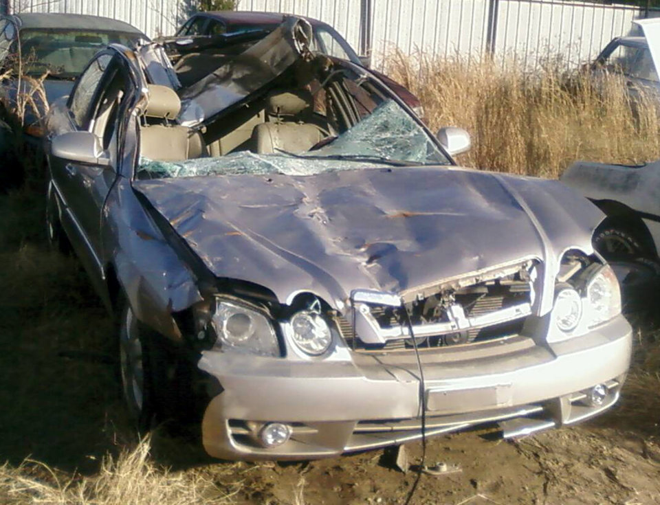 Photo - CAR ACCIDENT / DEATH: Edna Brinker, of Seminole, died Dec. 14, 2008, after her vehicle, a KIA sedan, struck a horse on State Highway 9 near Shawnee. The impact completely opened up the cab. Photo provided  ORG XMIT: KOD