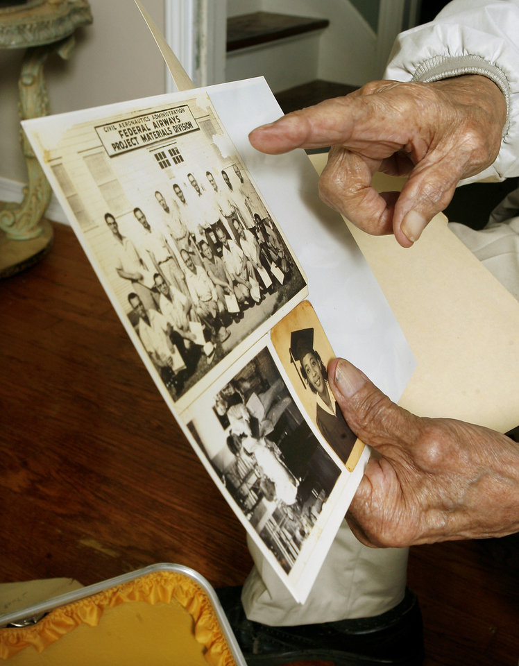 Oklahoma City resident Robert Jones, 103, pointing at early day photos of himself at his home in Oklahoma City Thursday, Nov. 6, 2008, while talking about this week's presidential election. BY PAUL B. SOUTHERLAND, THE OKLAHOMAN
