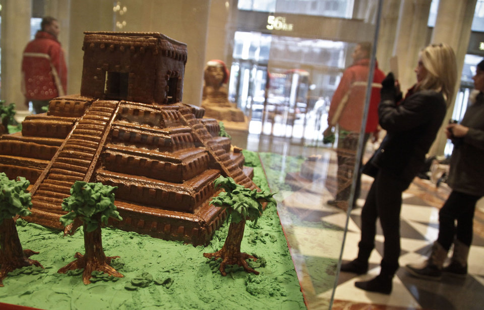 "This Nov. 30, 2012 photo shows ""Chichen Itza,"" a gingerbread creation from Butterfly Bakeshop, displayed in the lobby area of Le Parker Meridien hotel in New York.  The landmark-inspired creation is being exhibited with other over-the-top gingerbread houses from city restaurants in the annual display to benefit City Harvest, a food rescue organization for feeding the needy.  (AP Photo/Bebeto Matthews)"