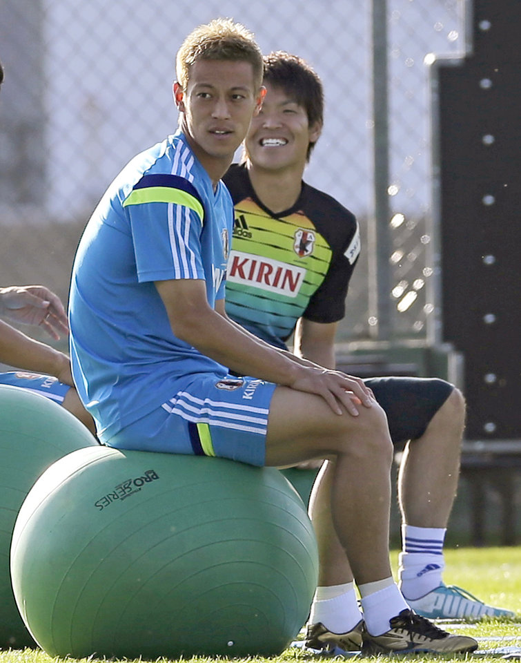 Photo - Japan's Keisuke Honda sits on an exercise ball during a training session of Japan in Itu, Brazil, Monday, June 16, 2014.  Japan play in group C of the 2014 soccer World Cup. (AP Photo/Shuji Kajiyama)