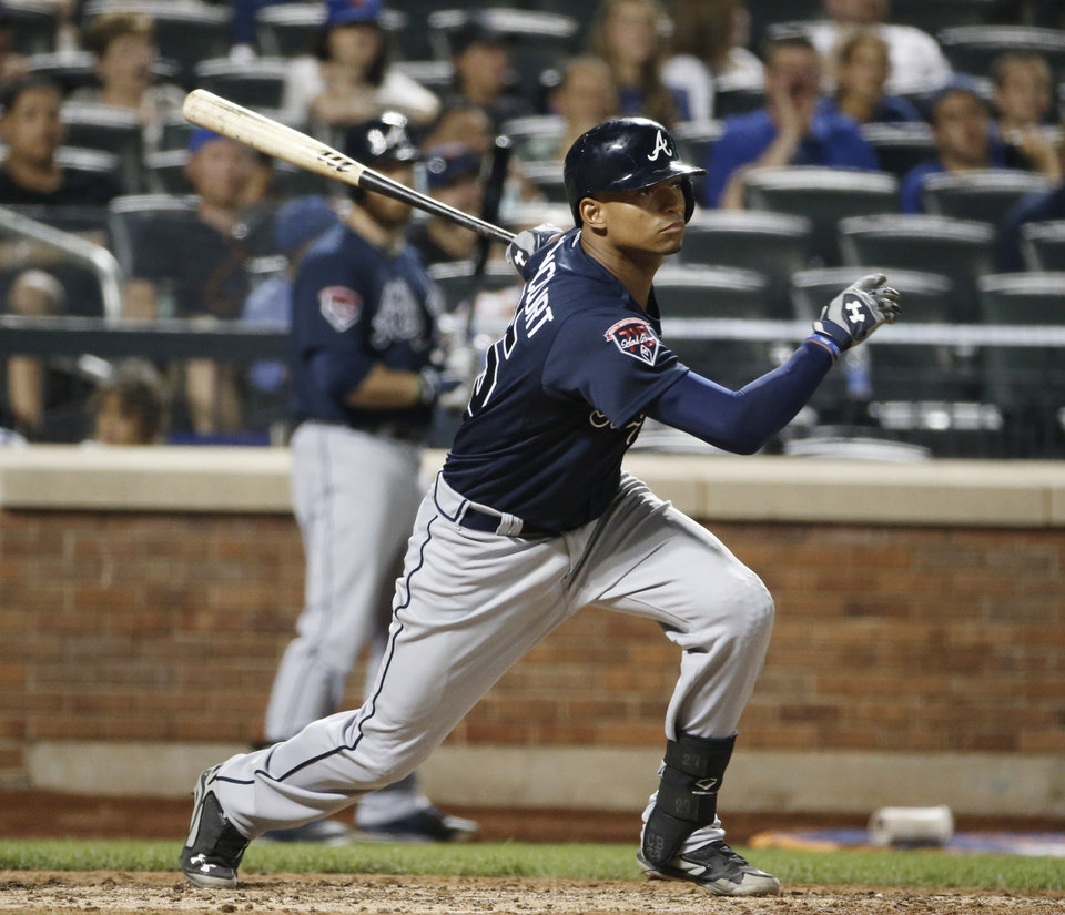 Photo - Atlanta Braves catcher Christian Bethancourt hits an eighth-inning RBI single that scored the Braves Chris Johson in a baseball game in New York, Monday, July 7, 2014. (AP Photo/Kathy Willens)