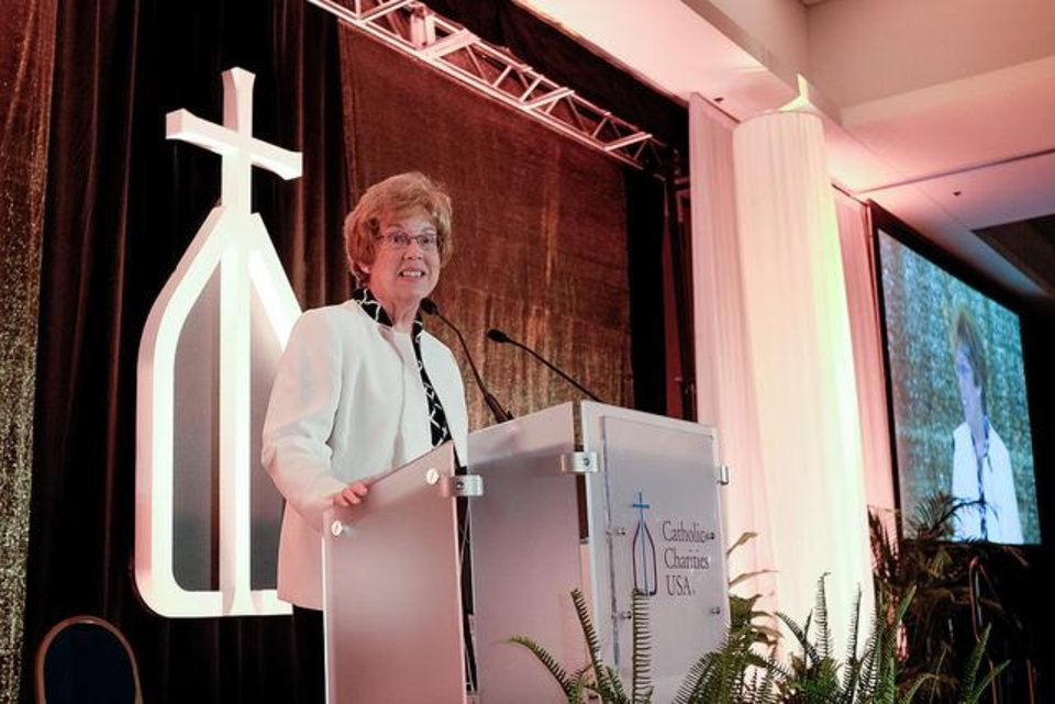 Photo - Sister Donna Markham, Ph.D., president and chief executive officer of Catholic Charities USA, talks during the organization's 2015 national gathering in Omaha, Neb. [Photo provided by Catholic Charities]