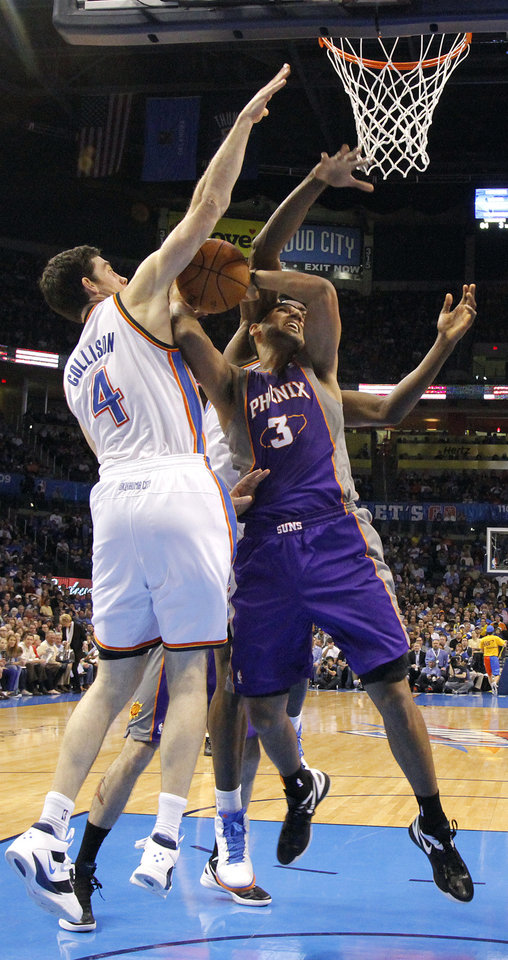 Photo - Oklahoma City Thunder power forward Nick Collison (4) defends on Phoenix Suns small forward Jared Dudley (3) during the NBA basketball game between the Oklahoma City Thunder and the Phoenix Suns at the Chesapeake Energy Arena on Wednesday, March 7, 2012 in Oklahoma City, Okla.  Photo by Chris Landsberger, The Oklahoman