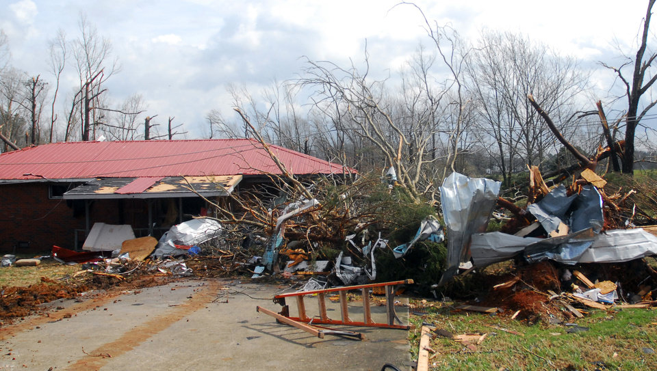 A home in Athens, Ala., was heavily damaged by a strong storm that swept through the area Friday, March 2, 2012.  A reported tornado destroyed several houses in northern Alabama as storms threatened more twisters across the region Friday. (AP Photo/Athens News Courier, Jean Cole)  ORG XMIT: ALATH103
