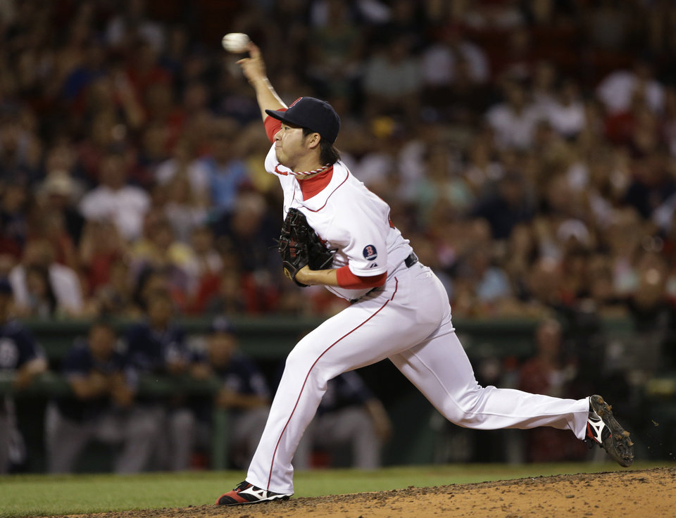 Photo - Boston Red Sox relief pitcher Junichi Tazawa delivers to the San Diego Padres in the eighth inning of an interleague baseball game at Fenway Park in Boston, Wednesday, July 3, 2013. (AP Photo/Elise Amendola)