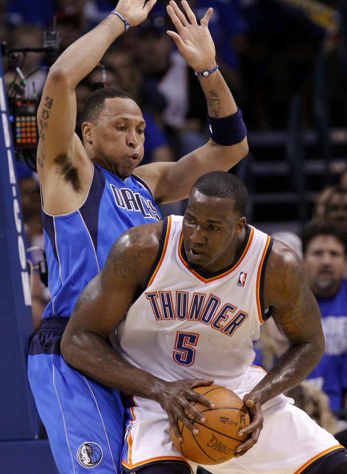 Shawn Marion (0) of Dallas defends Oklahoma City's Kendrick Perkins (5) during game 3 of the Western Conference Finals of the NBA basketball playoffs between the Dallas Mavericks and the Oklahoma City Thunder at the OKC Arena in downtown Oklahoma City, Saturday, May 21, 2011. Photo by Chris Landsberger, The Oklahoman