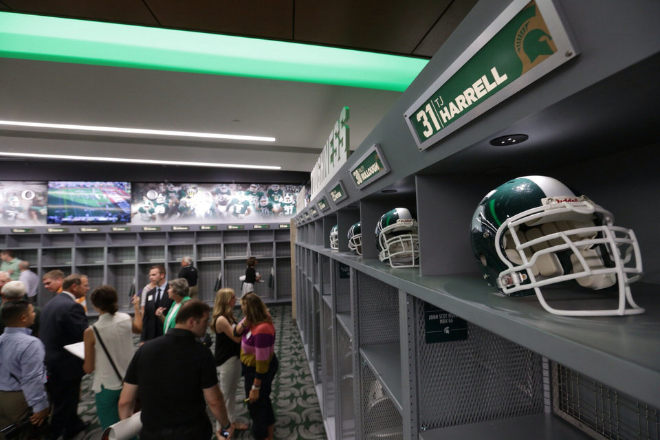 Photo - In this Monday, Aug. 25, 2014, photo, people look at the new home locker room during a tour of the new North End Zone Complex renovations at Spartan Stadium on the Michigan State Campus in East Lansing, Mich. (AP Photo/Detroit Free Press, Ryan Garza)  DETROIT NEWS OUT, TV OUT, INTERNET OUT, MAGS OUT, NO SALES, MANDATORY CREDIT DETROIT FREE PRESS