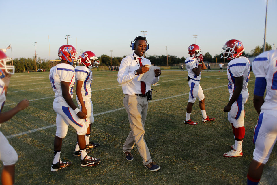 John Marshall�s first-year head coach Rashaun Woods took the field sporting a suit and tie this season. Photo by Doug Hoke, The Oklahoman