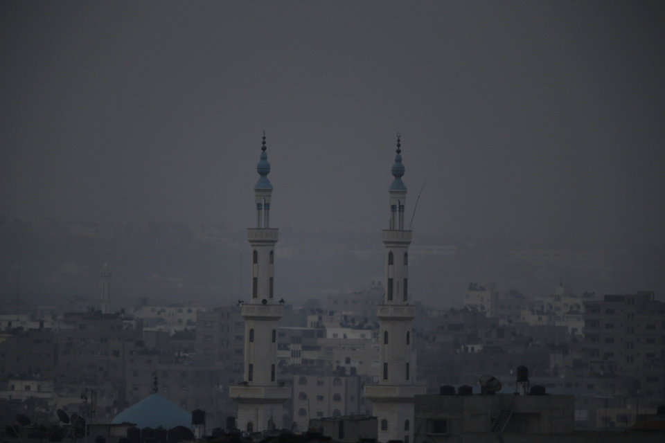 Photo - Minarets from a mosque are seen in this view of Gaza city, early Monday, July 28, 2014. Monday marked the beginning of the three-day Eid al-Fitr holiday, which caps the Muslim fasting month of Ramadan. Muslims usually start the day by visiting cemeteries, to pay their respects to the dead, and then exchange family visits. (AP Photo/Lefteris Pitarakis)