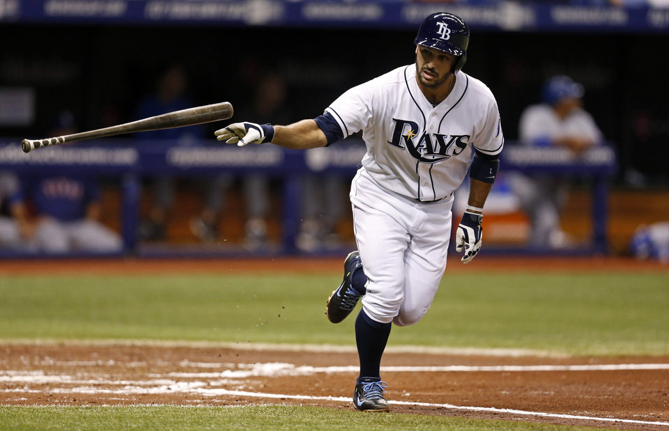 Photo - Tampa Bay Rays' Sean Rodriguez releases his bat after hitting a three-run home run against the Texas Rangers during the third inning of a baseball game Friday, April 4, 2014, in St. Petersburg, Fla. (AP Photo/Mike Carlson)