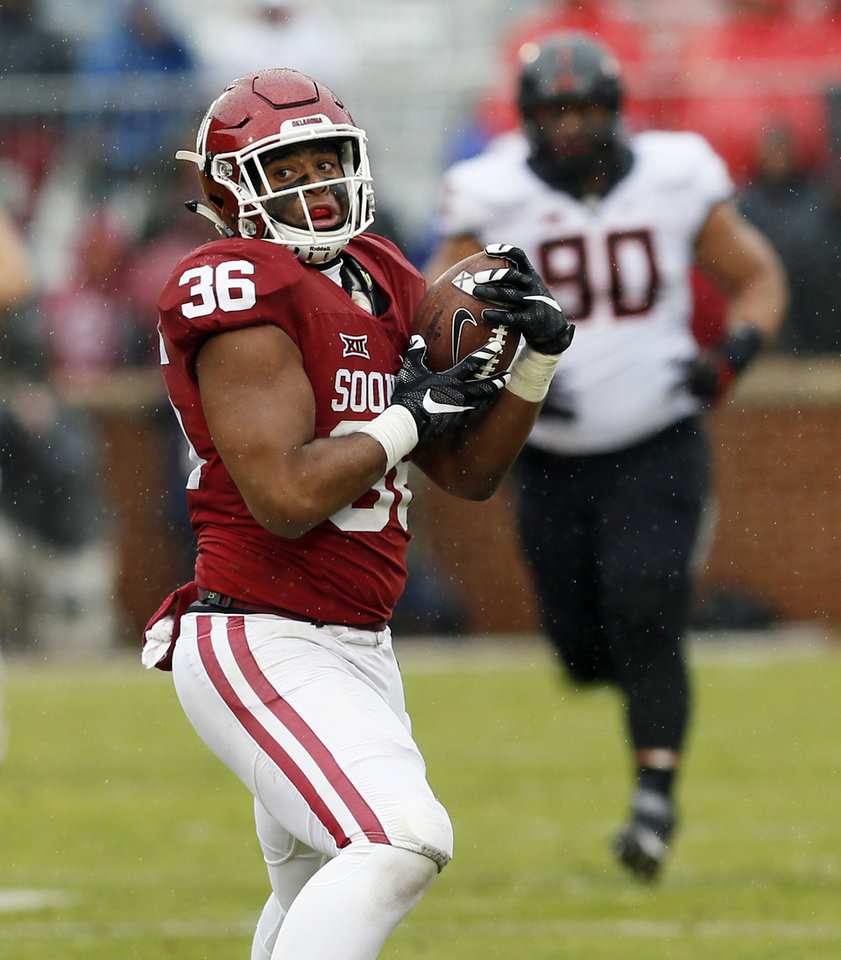 Photo - Oklahoma's Dimitri Flowers (36) catches a pass in the second quarter during the Bedlam college football game between the Oklahoma Sooners (OU) and the Oklahoma State Cowboys (OSU) at Gaylord Family - Oklahoma Memorial Stadium in Norman, Okla., Saturday, Dec. 3, 2016. Photo by Nate Billings, The Oklahoman