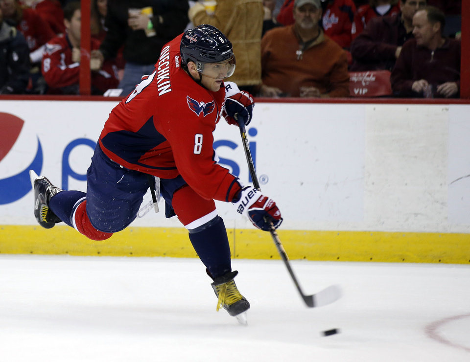 Washington Capitals right wing Alex Ovechkin (8), from Russia, scores a goal in the first period of an NHL hockey game against the Nashville Predators, Saturday, Dec. 7, 2013, in Washington. (AP Photo/Alex Brandon)