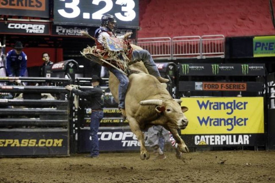 Photo -  Lucas Divino rides Mr. Majestic during a Professional Bull Riders competition last year at Sprint Center in Kansas City, Mo. [AP Photo/Colin E. Braley]