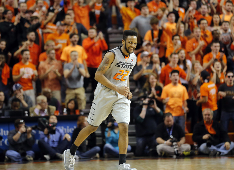 Photo - Oklahoma State's Jeff Newberry (22) celebrates during the final minute of the men's college basketball game between Oklahoma State University and the University of Kansas at Gallagher-Iba Arena in Stillwater, Okla.,  Saturday, Feb. 7, 2015. OSU won 67-62. Photo by Sarah Phipps, The Oklahoman