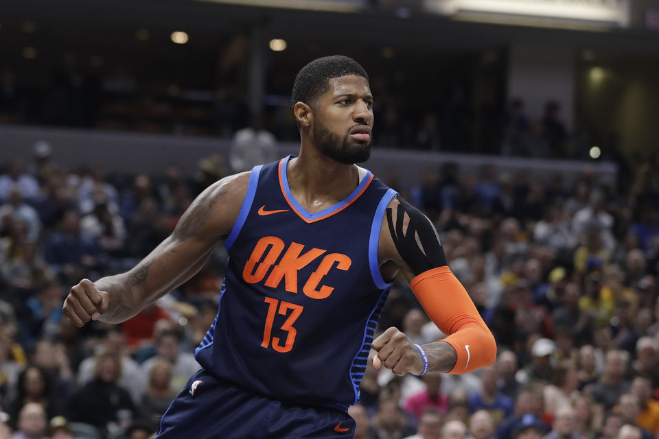 Photo - Oklahoma City Thunder's Paul George reacts after a dunk during the first half of an NBA basketball game against the Indiana Pacers, Thursday, March 14, 2019, in Indianapolis. (AP Photo/Darron Cummings)