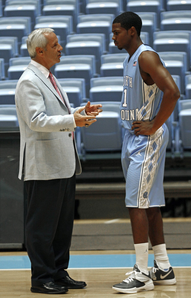 North Carolina coach Roy Williams, left, and Dexter Strickland talk during the team\'s NCAA college basketball media day in Chapel Hill, N.C., Thursday, Oct. 11, 2012. (AP Photo/Gerry Broome)