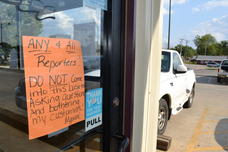 Photo - A sign on the door of a Prague restaurant warns reporters to stay out. Photo by Zeke Campfield, The Oklahoman