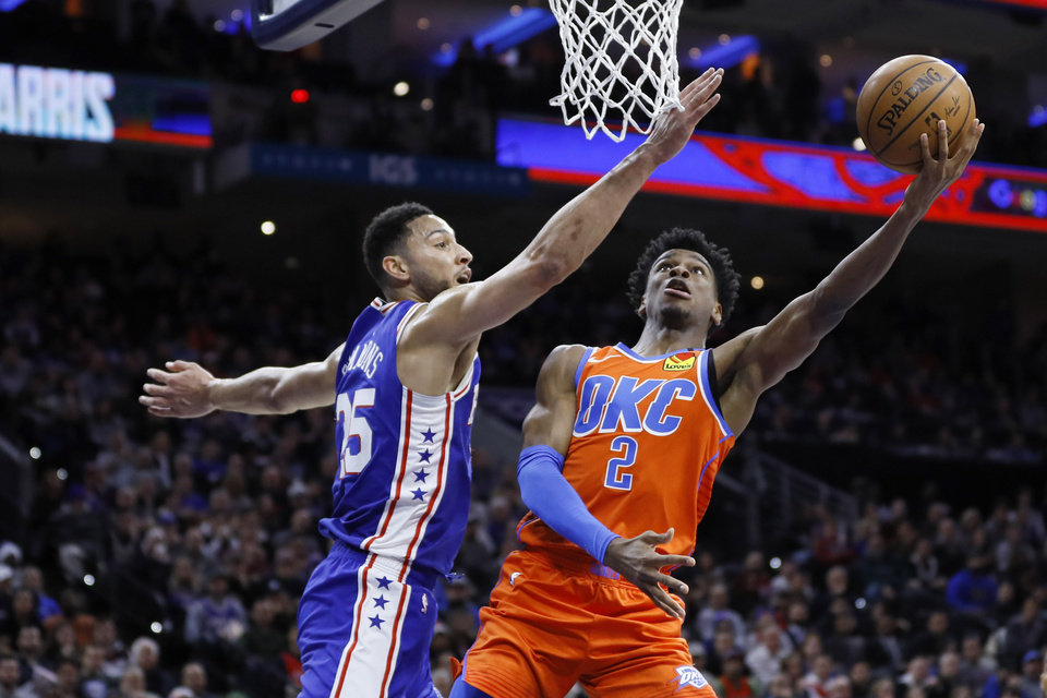 Photo - Oklahoma City Thunder's Shai Gilgeous-Alexander (2) goes up for a shot against Philadelphia 76ers' Ben Simmons (25) during the first half of an NBA basketball game, Monday, Jan. 6, 2020, in Philadelphia. (AP Photo/Matt Slocum)