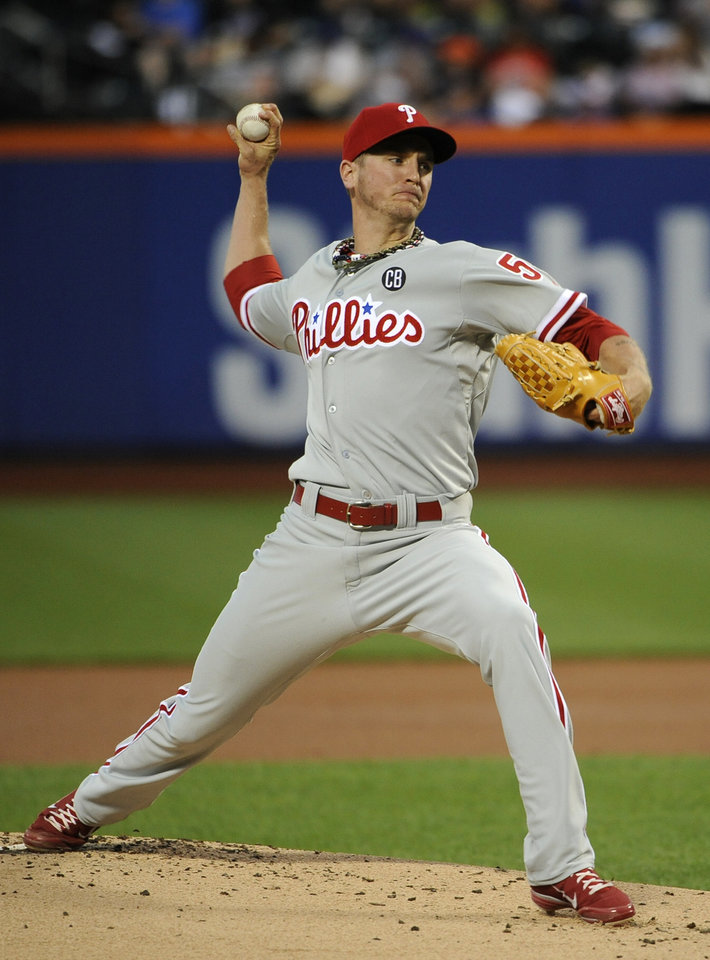 Photo - Philadelphia Phillies starter David Buchanan pitches against the New York Mets in the first inning of a baseball game at Citi Field on Friday, Aug. 29, 2014, in New York. (AP Photo/Kathy Kmonicek)