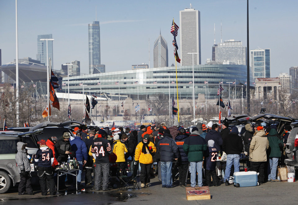 "Photo - FILE - In this Jan. 23, 2011 file photo, football fans tailgate in a parking lot south of Soldier Field, in the background, before a Chicago Bears game in Chicago. Chicago Mayor Rahm Emanuel is trying to persuade ""Star Wars"" creator George Lucas to put his planned museum of art and movie memorabilia in Chicago and is offering up a slice of real estate along the Lake Michigan shorefront, meaning fans dressed up as Han Solo and Darth Vader might have to cross paths with rowdy Bears tailgaters. A competing bid from San Francisco seems a more natural fit: it's Lucas' hometown, it's a premier center of technology and innovation and it's closer to the nation's movie-making heartland. (AP Photo/Charles Rex Arbogast, File)"
