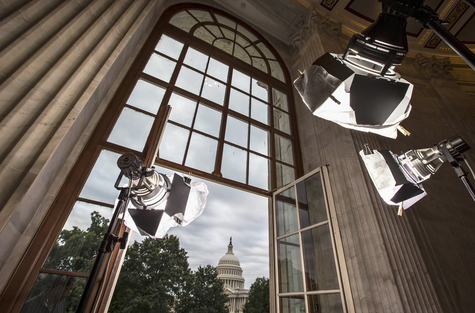 Photo - FILE - In this Sept. 9, 2013 file photo television news lights await the start of activity on Capitol Hill in Washington as both houses of Congress return to full legislative session.  Lawmakers are streaming back to Capitol Hill after this year's summer vacation for an abbreviated September session in which feuding Democratic and Republican leaders promise action to prevent a government shutdown while holding votes aimed at defining the parties for the fall campaign. Republicans control the House and want to pad their 17-vote majority, so they intend to follow this simple rule: first, do no harm. (AP Photo/J. Scott Applewhite, File)