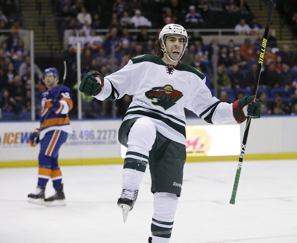 Photo - Minnesota Wild's Matt Moulson celebrates after scoring during the first period of the NHL hockey game against the New York Islanders, Tuesday, March 18, 2014, in Uniondale, New York. (AP Photo/Seth Wenig)