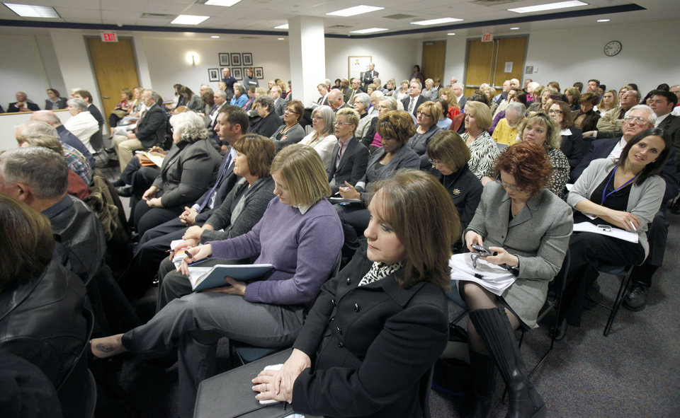 The meeting room is filled as DHS Director Howard Hendrick announces his retirement during a meeting of the Department of Human Services at the Sequoyah Memorial Office Building in Oklahoma City, OK, Tuesday, Jan. 24, 2012. By Paul Hellstern, The Oklahoman