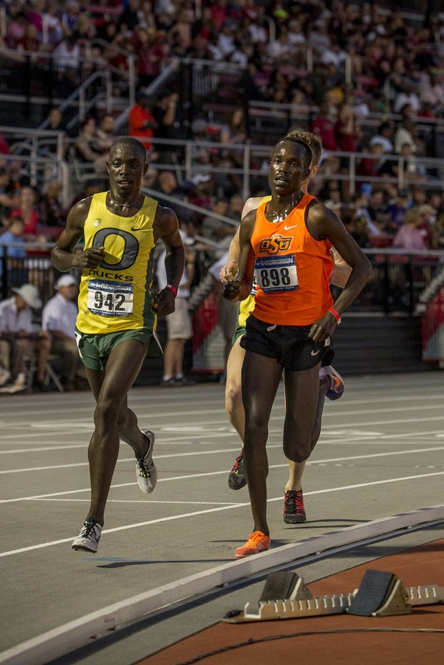 Photo -  Oklahoma State distance runner Shadrack Kipchirchir ran alongside Oregon's Ed Cheserek in the 10,000 meters at NCAA regionals. It was a sign of things to come. The standouts dueled again at the NCAA Track and Field Championships with Cheserek outkicking Kipchirchir by two seconds.    -  Clay Billman, OSU Athletics