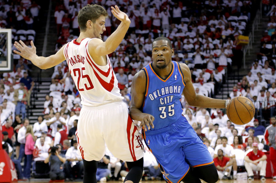 Oklahoma City\'s Kevin Durant goes past Houston\'s Chandler parsons during Game 3 in the first round of the NBA playoffs between the Oklahoma City Thunder and the Houston Rockets at the Toyota Center in Houston, Texas, Sat., April 27, 2013. Photo by Bryan Terry, The Oklahoman
