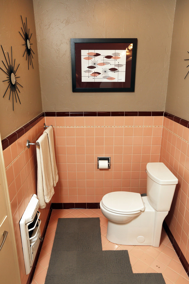 Photo - Mike Deatsch says he aimed to keep original features but add functionality when he renovated the two pink bathrooms in his 1949 home.  Steve Gooch - The Oklahoman