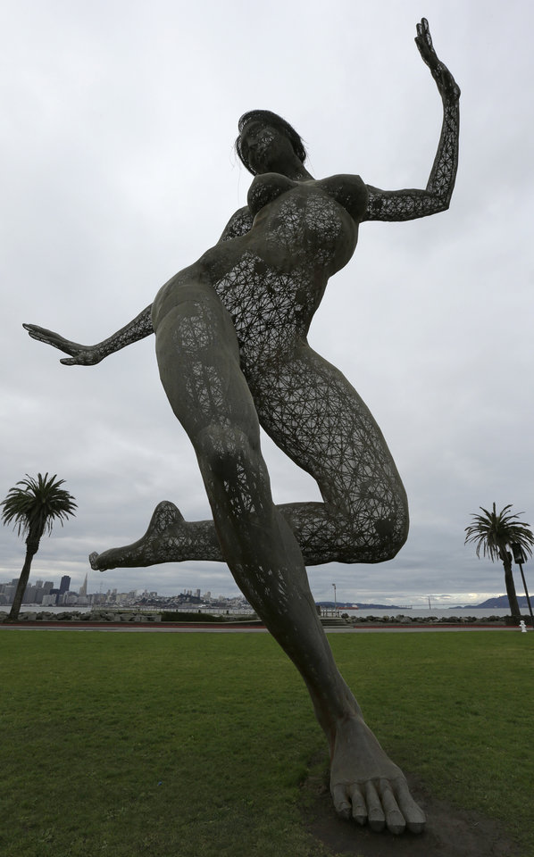 "Cloudy skies embrace the art sculpture ""Bliss Dance"" as unsettled weather moves into the Bay Area Sunday, Jan. 6, 2013, seen from Treasure Island in San Francisco Bay.   The National Weather Service says thunderstorms were in the forecast Sunday for the San Mateo and Monterey County coasts, with lightning strikes reported early Sunday. (AP Photo/Ben Margot)"