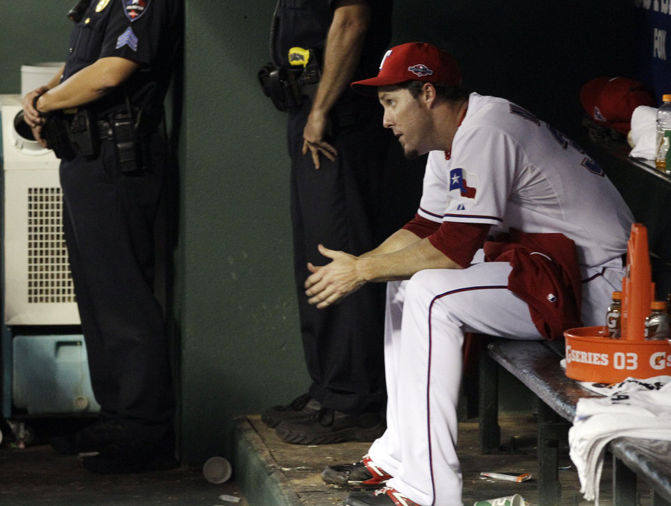Photo -   Texas Rangers relief pitcher Joe Nathan (36) watches the final moments of the American League wild-card playoff baseball game against the Baltimore Orioles, Friday, Oct. 5, 2012 in Arlington, Texas. Baltimore won 5-1. (AP Photo/Tony Gutierrez)