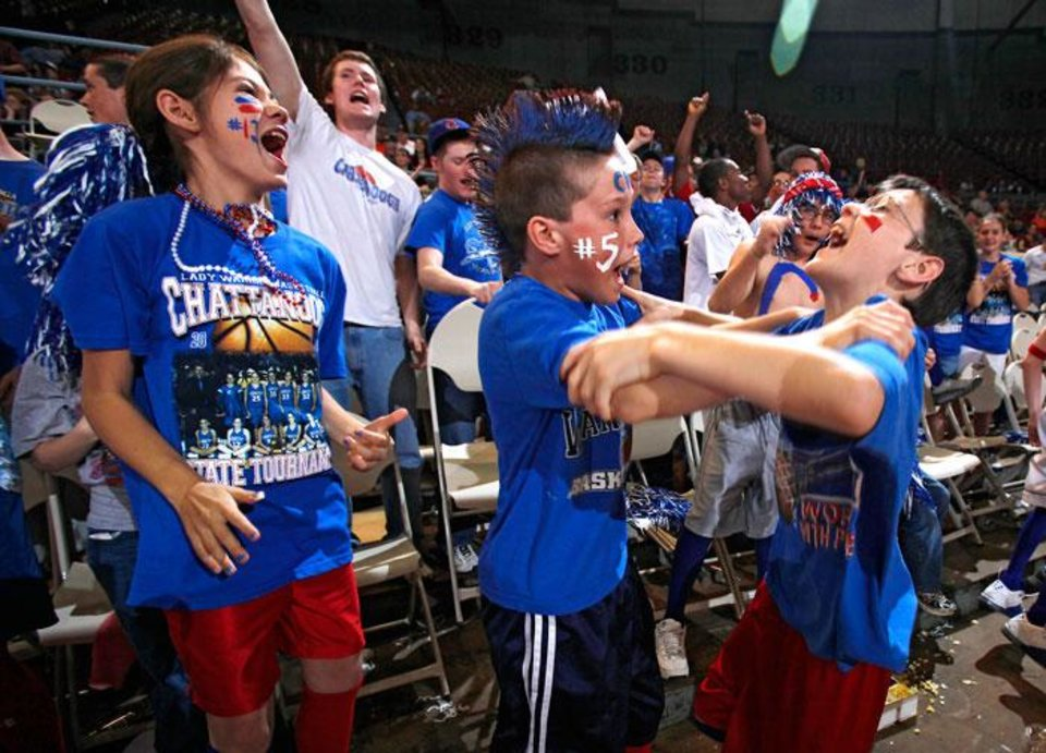 Photo -  Chattanooga fans Payton Howell and Corey Garza, from left, cheer on the Lady Warriors as they take on Varnum during the semifinals of the Class B girls Oklahoma State Basketball Championships at the State Fair Arena on Friday, March 6, 2009, in Oklahoma City, Okla.  PHOTO BY CHRIS LANDSBERGER, THE OKLAHOMAN