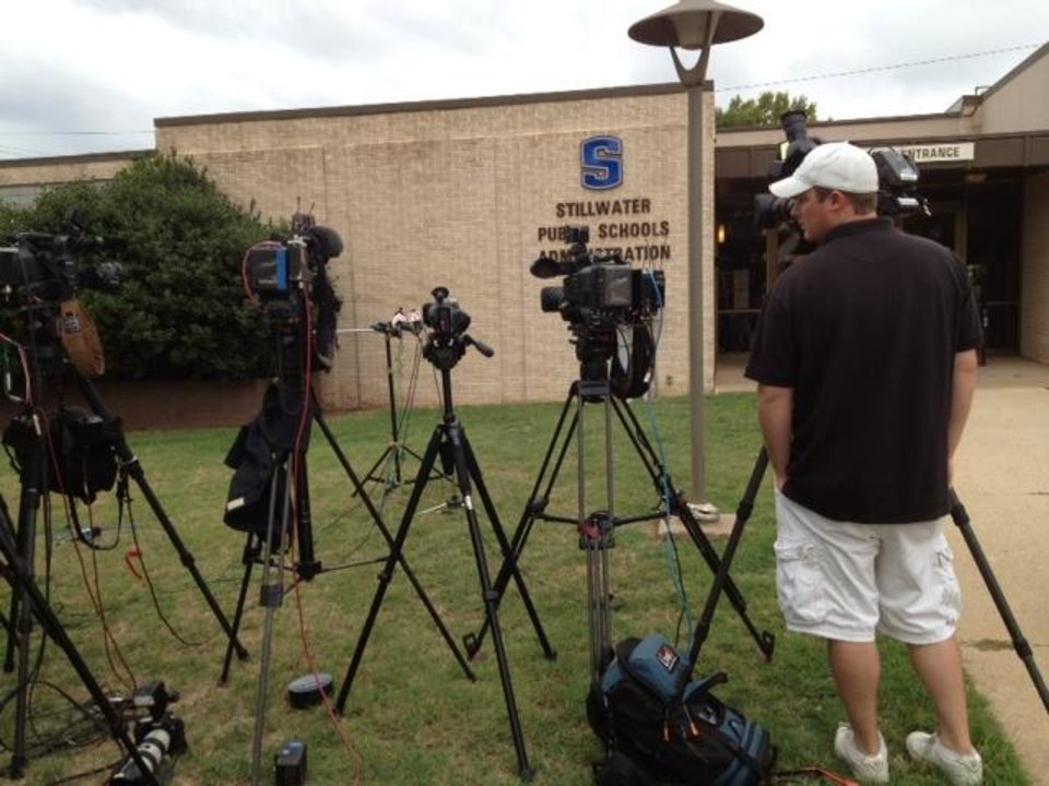 Photo - School officials prepare to address the media in Stillwater today. Photo by Jim Beckel