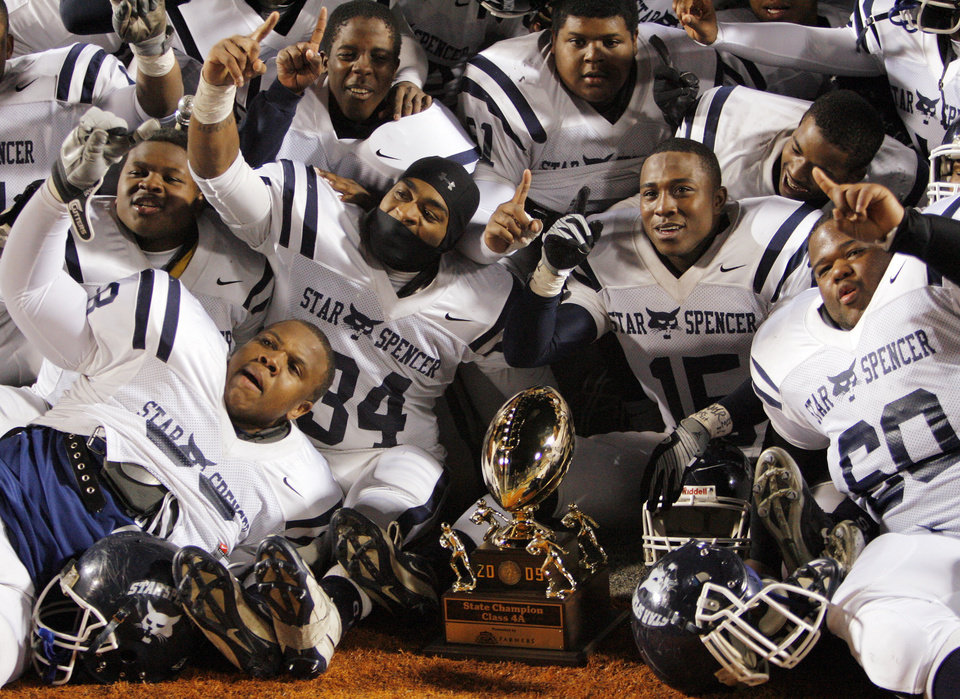 Photo - The Star Spencer Bobcats pose for a photo with championship trophy after the Class 4A high school football state championship game between Star Spencer and Douglass at Boone Pickens Stadium in Stillwater, Okla., Saturday, December 5, 2009. Star Spencer won, 34-21. Photo by Nate Billings, The Oklahoman