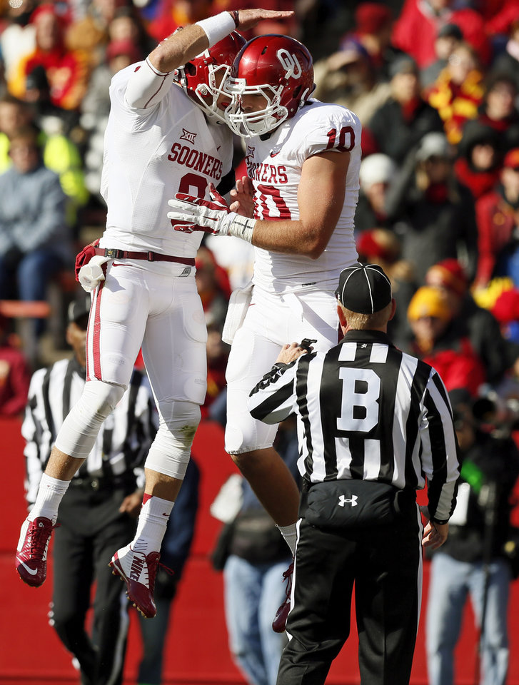 Photo - Oklahoma's Trevor Knight (9), left, and Blake Bell (10) celebrate a touchdown pass from Knight to Bell in the first quarter during a college football game between the University of Oklahoma Sooners (OU) and the Iowa State Cyclones (ISU) at Jack Trice Stadium in Ames, Iowa, Saturday, Nov. 1, 2014. Photo by Nate Billings, The Oklahoman