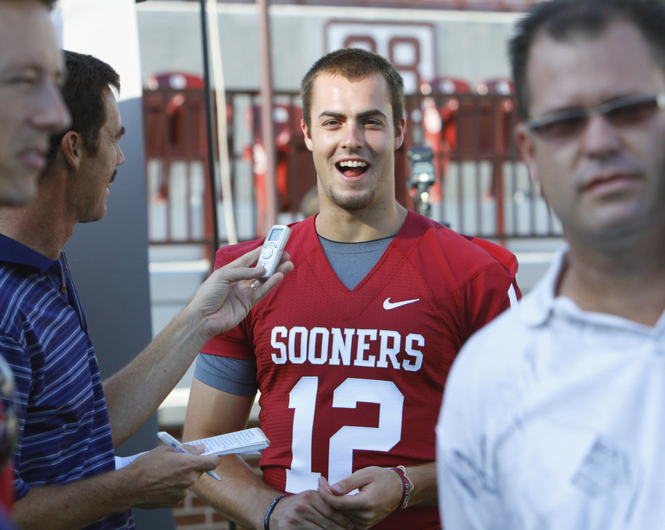 OU quarterback Landry Jones talks with the media on Friday in Norman. PHOTO BY STEVE SISNEY, THE OKLAHOMAN