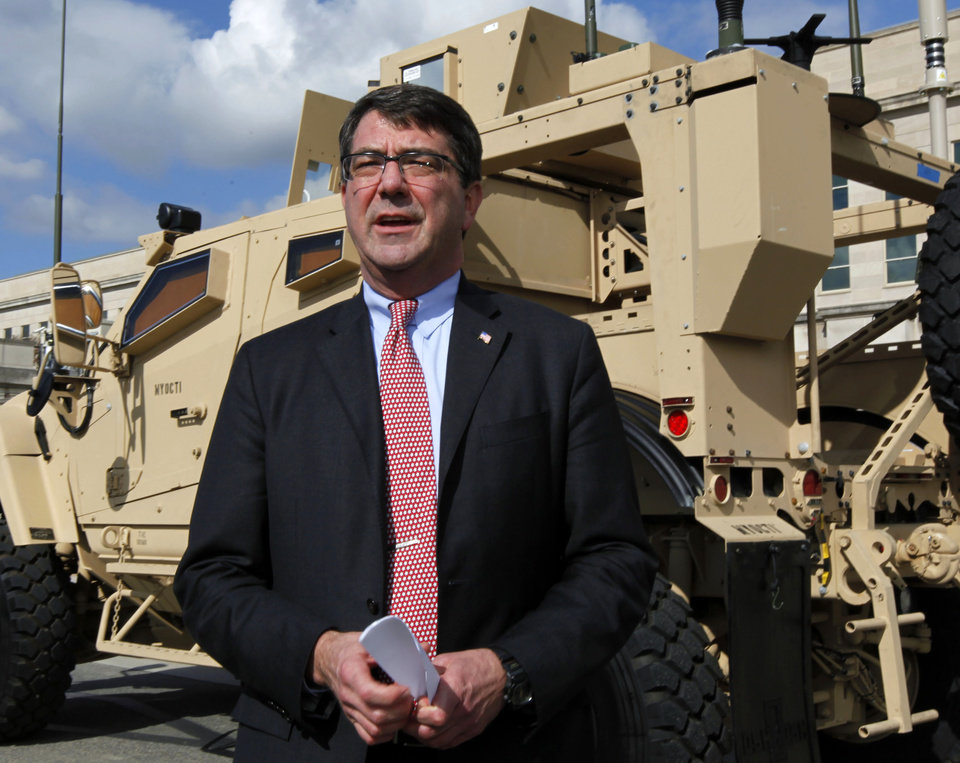 Photo - FILE - This Nov. 2, 2009 file photo shows Deputy Defense Secretary Ashton Carter standing in front of a MRAP all terrain vehicle (M-ATV) at the Pentagon. Senior administration officials tell The Associated Press that President Barack Obama could name his next defense secretary in December, far sooner than expected and perhaps in a high-powered package announcement along with his choice for secretary of state. The top names under consideration for defense secretary are former Republican Sen. Chuck Hagel of Nebraska, deputy defense secretary Ashton Carter, former top Pentagon official Michele Flournoy, and Sen. John Kerry, D-Mass.  (AP Photo/Manuel Balce Ceneta, File)