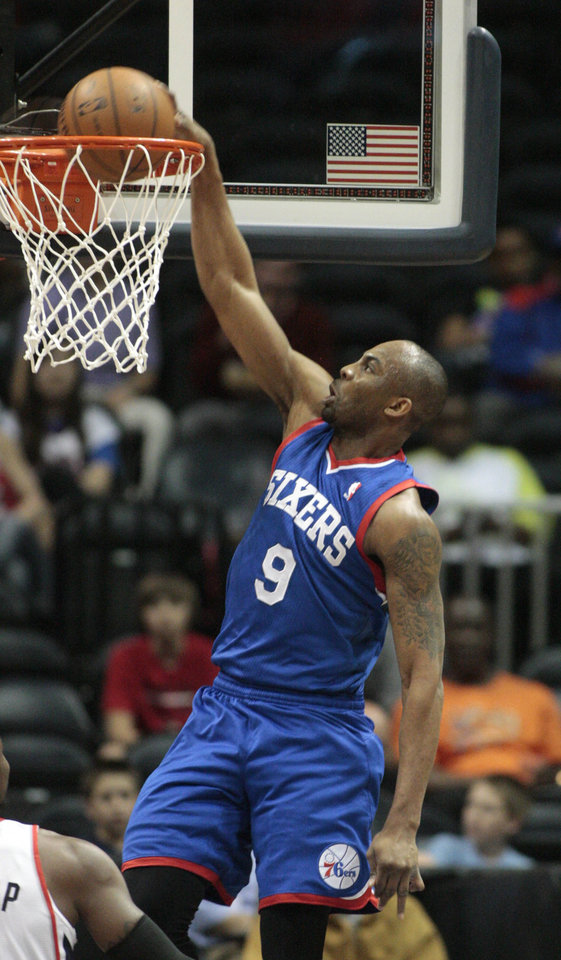 Photo - Philadelphia 76ers guard James Anderson (9) dunks in the first half of an NBA basketball game against the Atlanta Hawks Monday, March 31, 2014, in Atlanta. (AP Photo/Jason Getz)