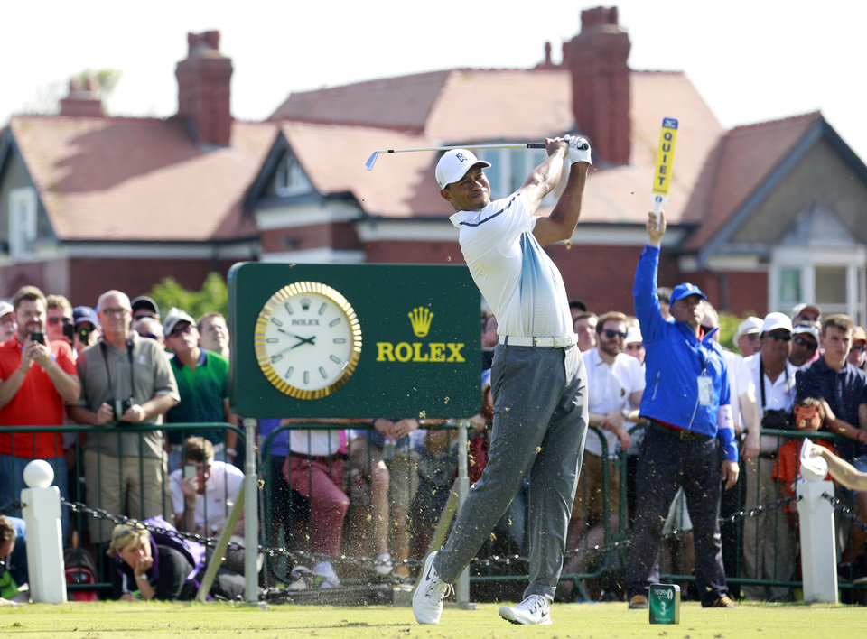 Photo - Tiger Woods of the US plays a shot off the 2nd tee during the first day of the British Open Golf championship at the Royal Liverpool golf club, Hoylake, England, Thursday July 17, 2014. (AP Photo/Peter Morrison)