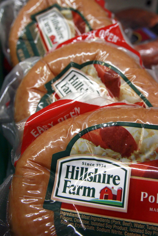 Photo - FILE - In this Monday, Feb. 7, 2011, file photo, Hillshire Farm products are seen on display in the meat case at Quality Market in Barre, Vt. Hillshire Brands is buying Pinnacle Foods, whose brands include Duncan Hines and Aunt Jemima, in a cash-and-stock deal valued at approximately $4.23 billion, the companies announced Monday, May 12, 2014. Hillshire Brands' roster of brands include Jimmy Dean meats, Ball Park hot dogs and Sara Lee frozen bakery goods. The combined company will use the Hillshire Brands name and be based in Chicago. (AP Photo/Toby Talbot, File)