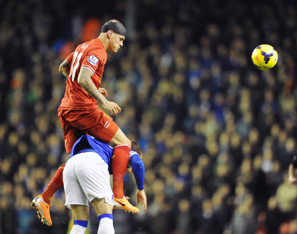 Photo - Liverpool's Martin Skrtel top, and Everton's Ross Barkley battle for the ball during their English Premier League soccer match at Anfield in Liverpool, England, Tuesday Jan. 28, 2014. (AP Photo/Clint Hughes)