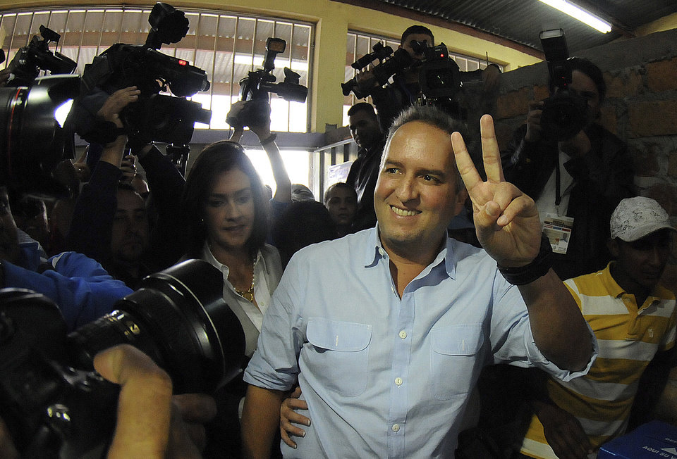 Ricardo Alvarez of the National Party gestures after casting his vote during his party's primary elections in Tegucigalpa, Honduras, Sunday Nov. 18, 2012. The political parties of Honduras are holding primary elections as a third party is trying to break the country's 114- year-old two party system. (AP Photo/Fernando Antonio)