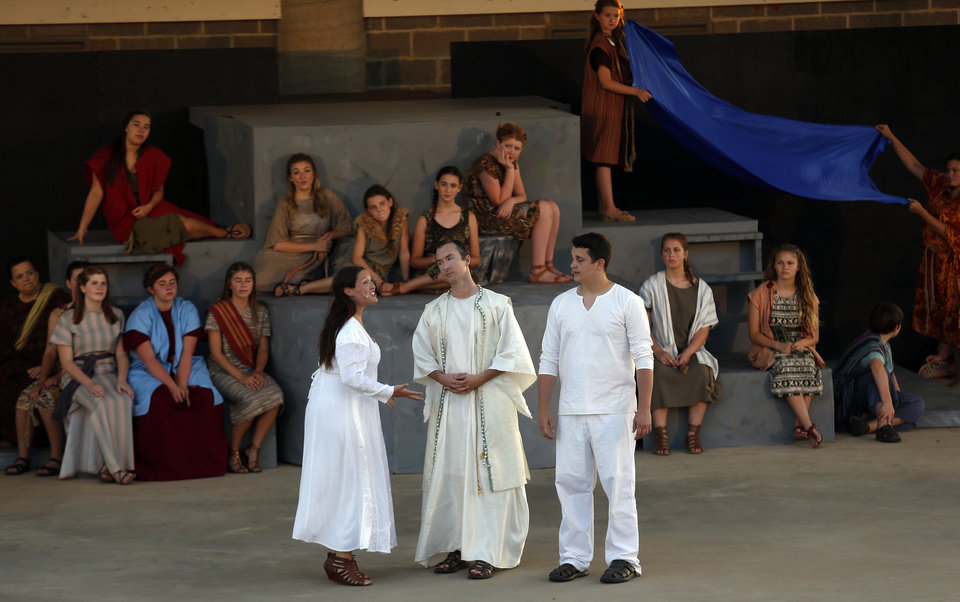 """Photo -  Jenny Rottmayer, Aaron Kellert, center, and Nate Stukey perform during Upstage Theatre's production of """"Children of Eden"""" at J.L. Mitch Park Amphitheater in Edmond. PHOTO BY SARAH PHIPPS, THE OKLAHOMAN   SARAH PHIPPS -"""