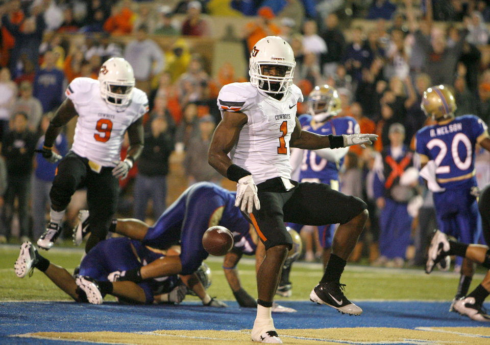 Photo - Oklahoma State's' Joseph Randle (1) celebrates a touchdown during a college football game between the Oklahoma State University Cowboys and the University of Tulsa Golden Hurricane at H.A. Chapman Stadium in Tulsa, Okla., Sunday, Sept. 18, 2011. Photo by Sarah Phipps, The Oklahoman