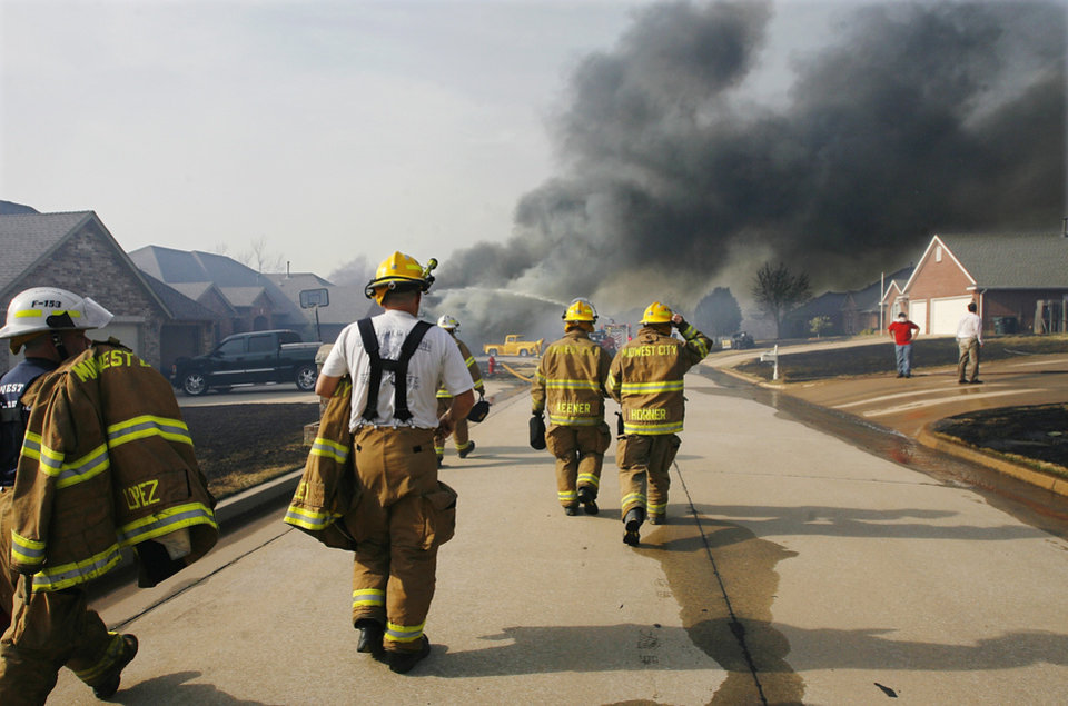 Fresh Midwest City firefighters arrive at scene of multiple house fires on Westbury Street in the Oakwood East Addition in Midwest City  Thursday, April 9, 2009.  Two homes were destroyed on this street. Photo by Jim Beckel, The Oklahoman